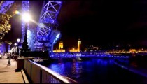 Time-lapse of the London Eye and Big Ben at night.