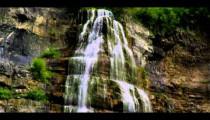 Tilt shot of the full height of Bridal Veil Falls in Provo, Utah.