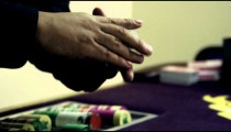 Royalty Free Stock Footage of Dealer shuffling and fanning cards.
