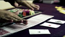 Royalty Free Stock Footage of Fanning cards in two hands, showing, then replacing.