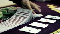 Royalty Free Stock Footage of Dealer shuffling and splitting the deck.