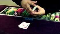 Royalty Free Stock Footage of Dealer placing cards on the table and fanning the deck.