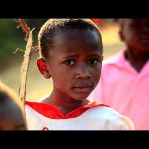 Kids smiling at the camera in Kenya.