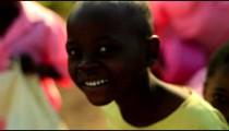 Kenyan boys and girls smiling and laughing.