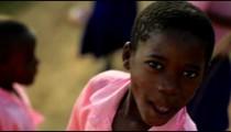 Kenyan girl smiling at the camera.