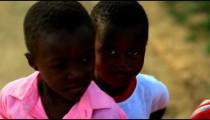Kenyan boy hiding behind another boy.