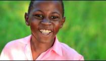 Little jumpy Kenyan boy smiling.
