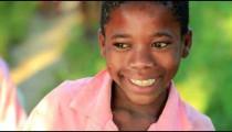 Little Kenyan girl smiling at the camera.
