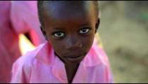 Kenyan boy smiling at the camera.