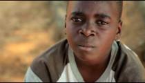 Sad Kenyan boy looking at the camera.