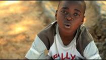 Little Kenyan boy talking to the camera.