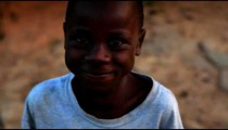 Little Kenyan boy laughing and smiling at the camera.