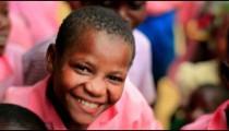 Kids smiling into the camera in Kenya.