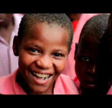 Other Kids smiling into the camera in Kenya.