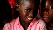 Group of Kenyan girls smiling at the camera.