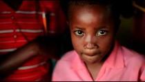 Young Kenyan girl looking at the camera.