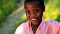 Young Kenyan girl smiling at the camera.