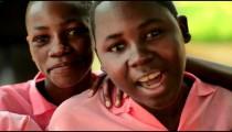 Kenyan girls looking at the camera.