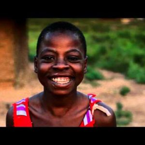 Kenyan girl smiling and laughing at the camera.