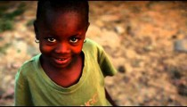 Kenyan girl with earrings smiling.