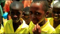 Kenyan kids smiling at the camera.
