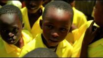 Another Kenyan kids smiling at the camera.