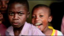 Kenyan kids looking at the camera and smiling.