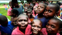 Kids swarm around the camera in Africa part 2.