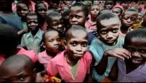 Kids swarm around the camera in Africa part 3.