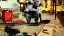 Metal worker working on a Kenyan village.