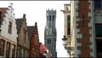Royalty Free Stock Footage of Belfry seen above roofs in Brugge, Belgium.