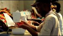 Row of women and men sewing in Kenya.