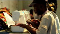 Another Row of women and men sewing in Kenya.
