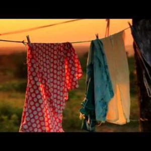 Close up shot of a Kenyan hut with a clothesline.