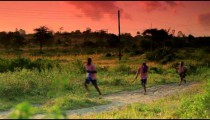 Another Group of Kenyan students walking to school at sunrise.