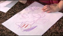 Royalty Free Stock Footage of Child drawing a picture with crayons.