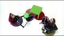 Royalty Free Stock Footage of Young twin girls playing catch with a green ball on white background.
