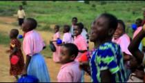 Some Children running alongside a car in Kenya.