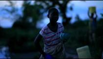 An African Child gathering water near a village in Kenya.