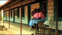 Children from Kenya sitting on a bench in a village in Kenya.