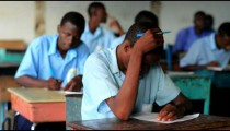 Students doing classwork in Kenya.