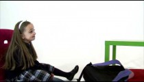 Royalty Free Stock Footage of Young twin girls relaxing after school on white.