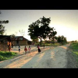Young African children playing in dirt roads in Kenya.