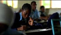 Student doing classwork in Kenya.