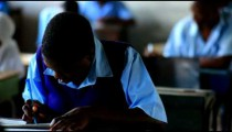 Student working in school in Kenya.