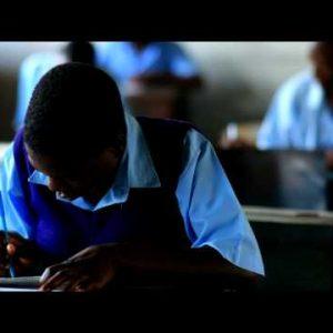 Student working in school in Kenya.