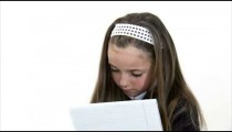Royalty Free Stock Footage of Young girl doing homework gets an idea.