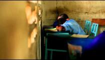 Students sleeping in school in Kenya.