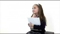 Royalty Free Stock Footage of Young girl doing homework on white.