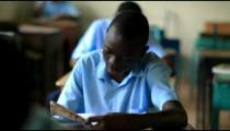 School boy reading a book in class in Kenya.